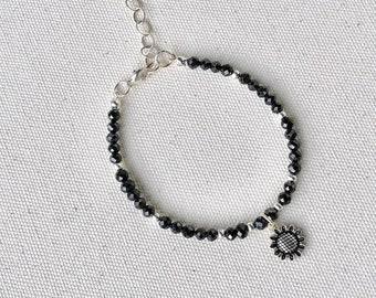 Black spinel bracelet with 925 sterling sunflower charm