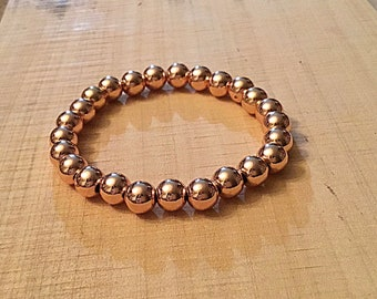 Bright rose gold plated heavy, 8mm beaded bracelet
