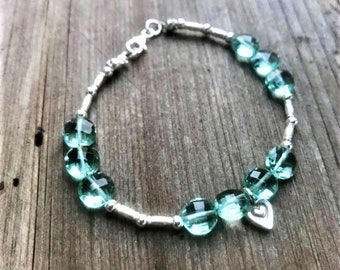 Green amethyst hydro quartz coin bracelet with Karen Hill Tribe Silver heart charm and tube beads and tiny sterling spacers