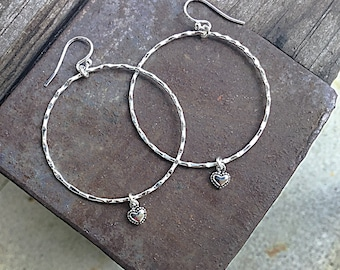Sterling silver large hoop earrings with wavy texture on sterling ear wires with sterling heart charms