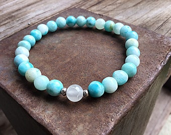 Blue hemimorphite 6mm beaded bracelet with calcite feature bead and Karen Hill Tribe silver imprint seed beads