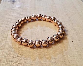 Light Rose gold hematite, heavy 8mm beaded bracelet