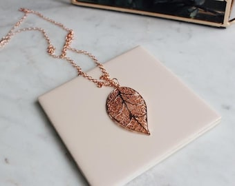 Long, filagree leaf, rose gold plated necklace, on rose gold rolo chain