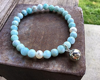 Genuine 6mm ocean blue larimar beaded bracelet with freshwater pearls and a Karen Hill Tribe silver imprint ball charm