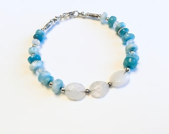 Natural Larimar smooth rondelles, moonstone pebblesand rondelle beads, Karen Hill imprint tube and tiny daisy imprint beads
