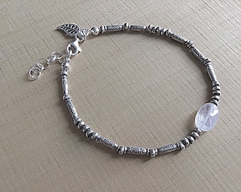 Karen Hill Tribe mix of imprint tiny seed beads and daisy imprint tube beaded bracelet with rainbow moonstone oval and sterling leaf charm