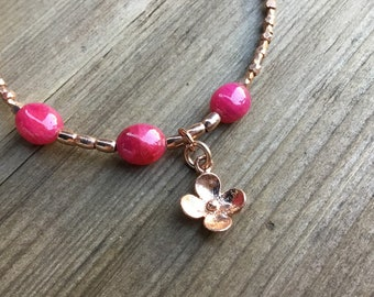 Ruby smooth ovals and Karen Hill Tribe rose gold vermeil tiny beaded bracelet with rose gold vermeil flower charm