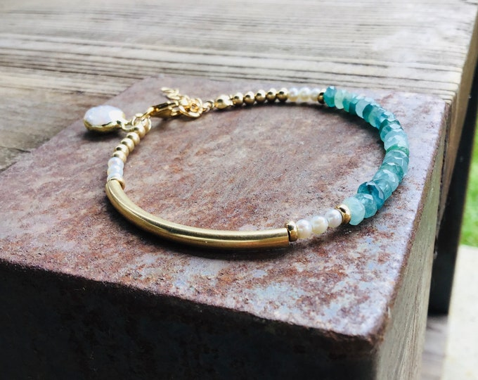 Rare grandidierite rondelle beaded bracelet with 14k gold fill curved bar, pearls, freeform pearl charm,  clasp bracelet