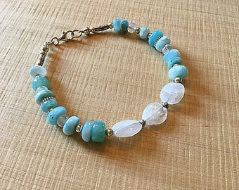 Natural Larimar smooth rondelles, moonstone pebble bracelet rondelle beads, Karen Hill imprint tube and tiny daisy imprint beads