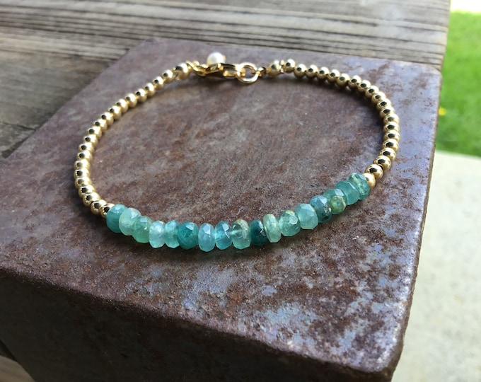 Rare grandidierite rondelle beaded bracelet with gold filled round beads, clasp