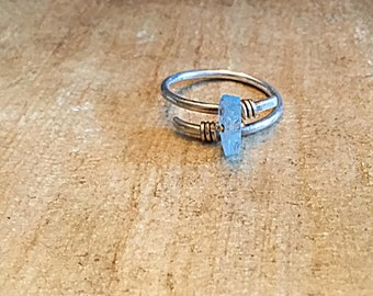 High grade aquamarine ring wrapped with gold wire on textured sterling,swirling, wrap around, solitaire