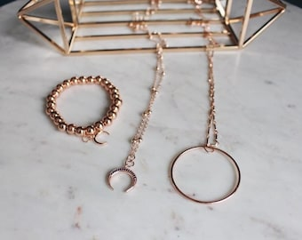 Rose gold minimalist pave horn pendant necklace, pictured centre on rose gold satellite chain