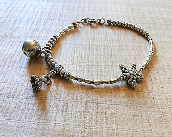 Karen Hill Tribe Silver bracelet with ball bell charm and flower charm and starfish bead