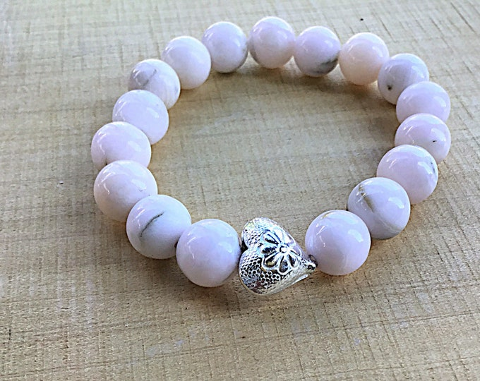 10mm high grade pink mangano calcite beaded bracelet with a Karen Hill Tribe flower printed heart feature bead stacking