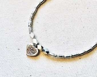 Karen Hill Tribe faceted hexagon and tube beaded bracelet with Karen Hill Tribe rose heart charm