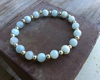 Genuine 7mm ocean blue larimar beaded bracelet with sterling spacers.