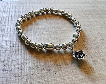 925 sterling silver 6mm smooth round and oval beaded bracelet with sterling silver flower charm