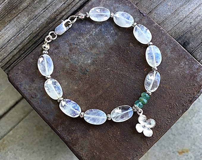 High grade rainbow moonstone oval, grandidierite and Karen Hill Tribe beaded bracelet with a sterling silver flower charm