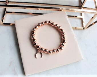 Rose gold plated beaded bracelet with moon charm