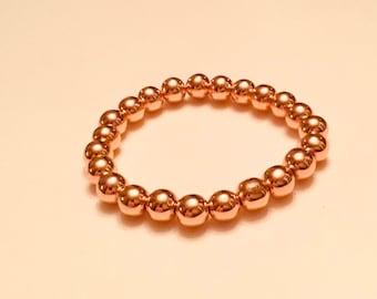 Bright rose gold hematite, heavy, 8mm beaded bracelet