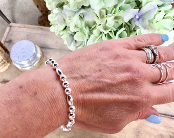925 sterling silver 6mm smooth round and oval beaded bracelet with sterling silver heart charm