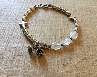 Moonstone, silver, Karen Hill Tribe silver bracelet with sterling cross beads, lotus flower and bell charm