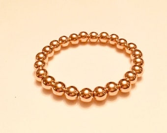 Light Rose gold hematite, heavy 8mm beaded bracelet