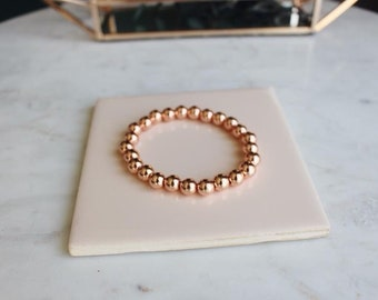 Rose gold plated 8mm beaded bracelet