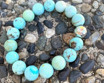 10mm Light green blue turquoise beaded bracelet with a Karen Hill Tribe hammered feature bead ,stacking
