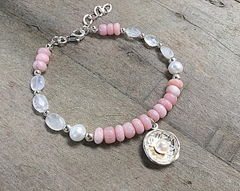 Pink Peruvian opal rondelles withmoonstone pebbles with freshwater pearls and sterling spacers,beaded bracelet, pearl in sterling disc charm