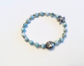 Genuine 7mm larimar bracelet with Karen Hill Tribe Silver fish and starfish bead, sterling spacers