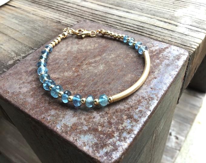 Moss aquamarine smooth rondelles bracelet with 14k gold fill curved bar , gold spacers,clasp bracelet