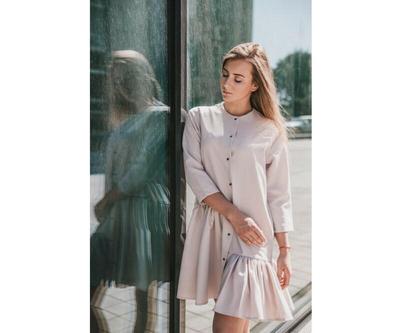 8cb0caeba8f Extravagant asymmetrical pleated shirt dress with 3/4 sleeves