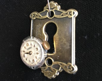 pendant with watch movement