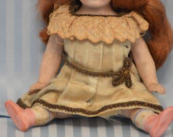 ANTIQUE all bisque Kestner with ORIGINAL dress