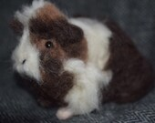 A needle felted guinea pig