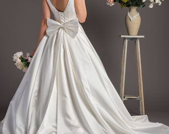 6120cb4b84a Ivory deep plunge neck satin wedding dress with bow