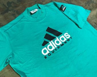 b58082b8a6 Vintage 90s Adidas T-Shirt size XL