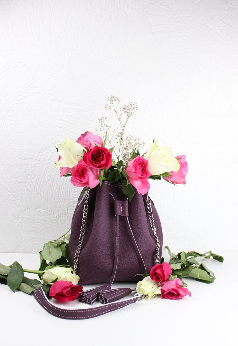 small pom poms chain strap and cord closure handmade, Small bucket bag in real purple grained leather