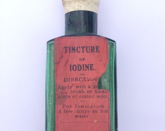 Tincture of iodine glass bottle with label. Old medical curios