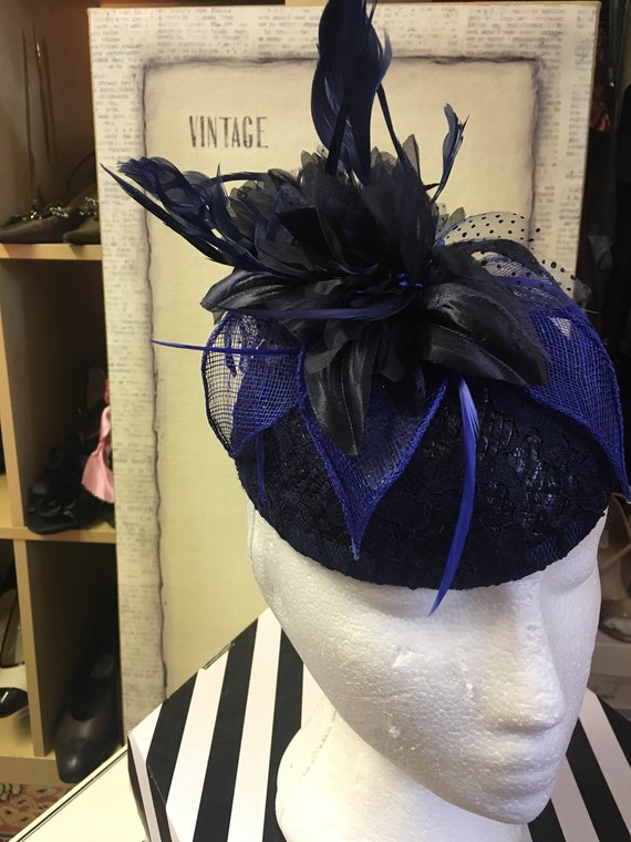 Vintage bespoke hat with blue feather