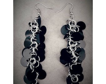 Black sequined earrings on silver-colored chain