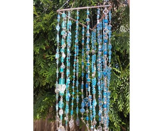 Hand Crafted glass Suncatcher in gorgeous blues and greens