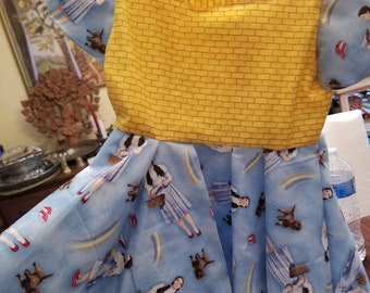 Wizard of Oz Baby Dresses. Dorothy twirl dress. Two styles. Yellow Brick Road infant dress