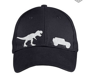 8a0a911e7f7 T-Rex Chasing Jeep Wrangler Hat- Jeep Hat - Black