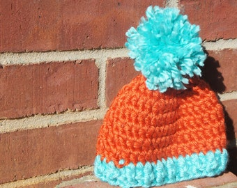 Orange and baby blue hat with pompom 0-3 months