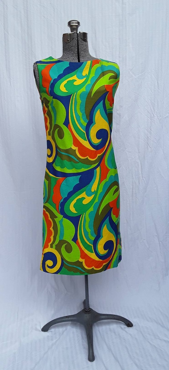 Green plus Mod 60's psychedelic patterned dress.