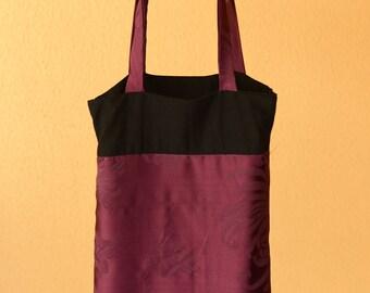 Reversible black and plum satin tote bag