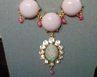 Pale lavender necklace with pink accents and oval pendant with green and pink color