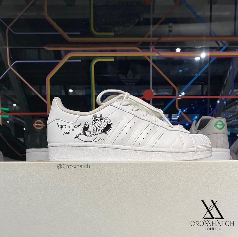 Monopoli Uomo Borse soldi Adidas Superstar Customs IKudZaeb